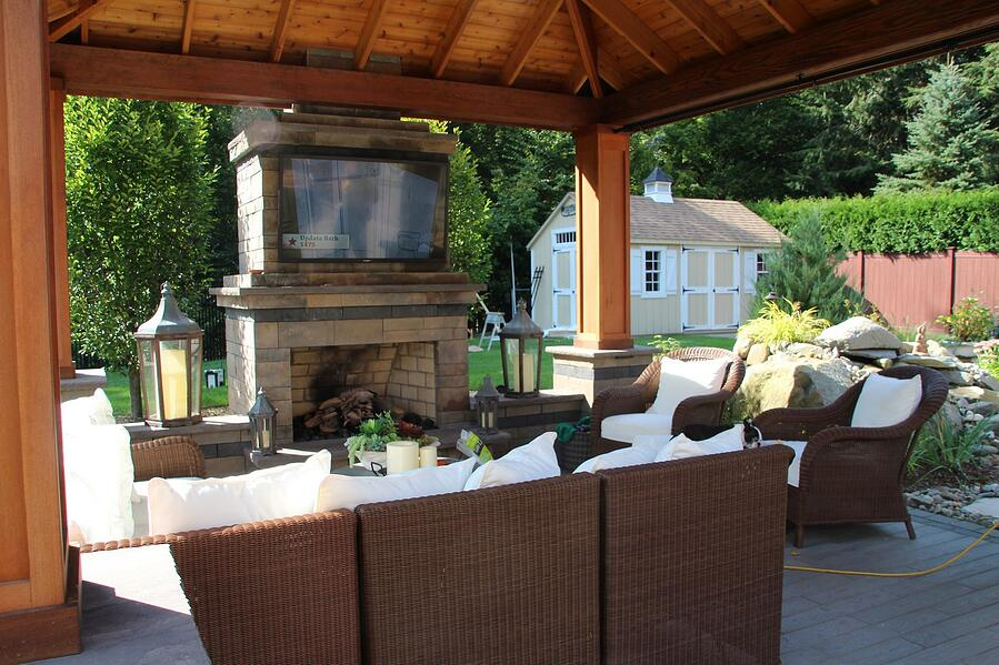 Covered patio with fireplace and sitting area