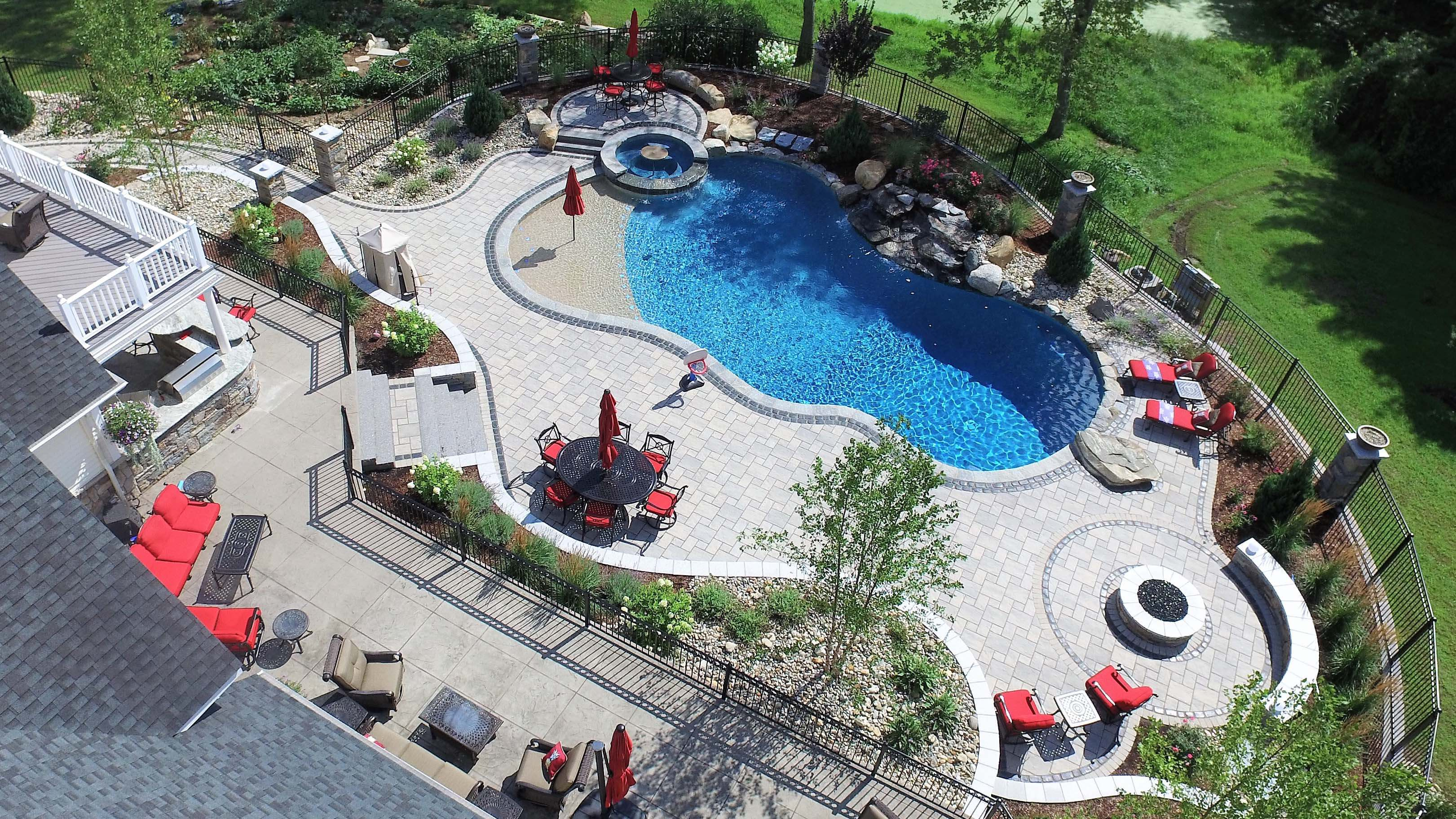 gunite-pool-with-waterfall-and-pool-patio