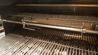The rotisserie rack and burner of a Summerset grill.