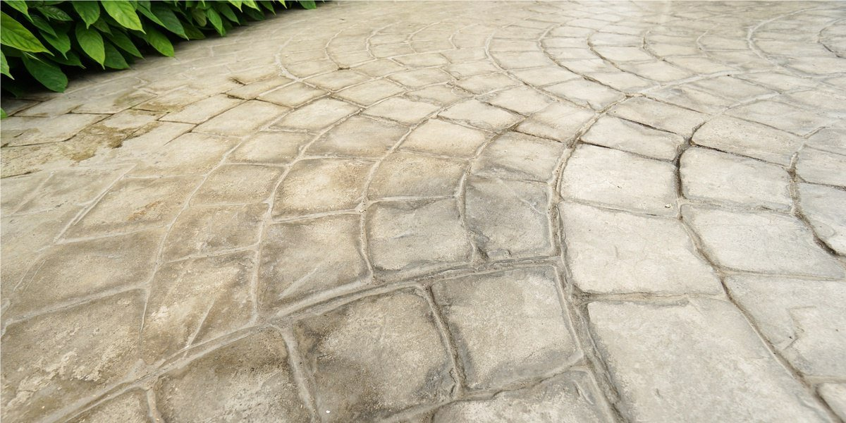 A Side-By-Side Comparison of Stamped Concrete and Pavers